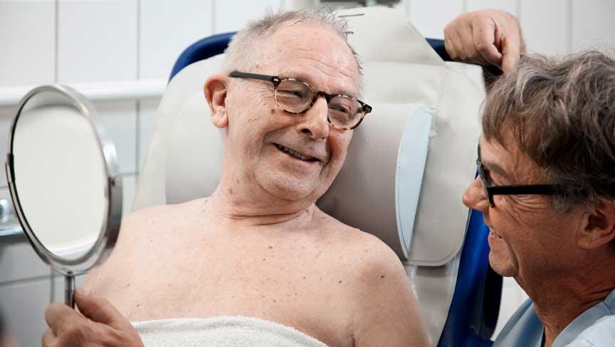 Minimaliseren van rugletsel bij het douchen van patiënten met een verminderde functionele mobiliteit
